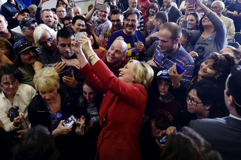 Democratic presidential candidate Hillary Clinton takes a selfie with supporters after speaking at a campaign rally in Las Vegas, Nevada February 14, 2016. REUTERS/David Becker - RTX26XWP